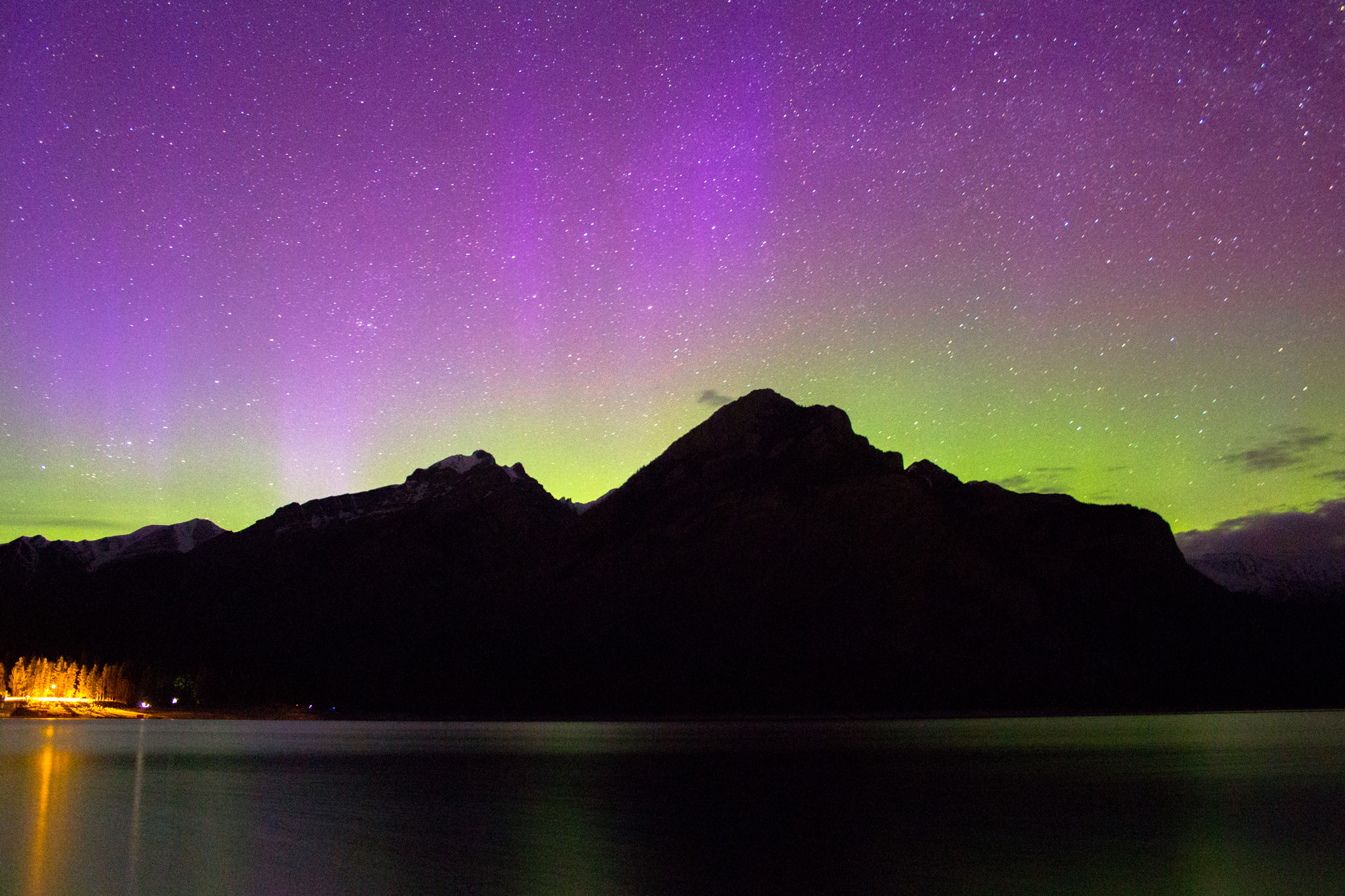 Catching the Northern Lights at Lake Minnewanka is one of the top things to do in Banff all year round